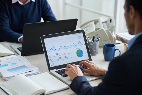 Employee using computer to analyze data