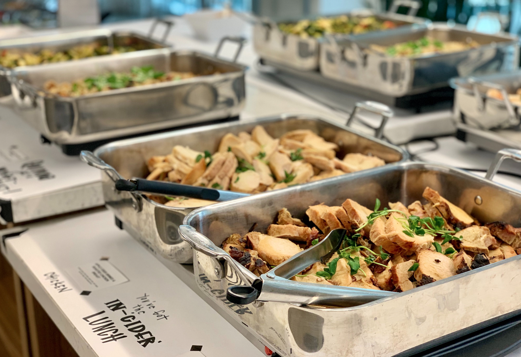 Catering lunch line with pans of food